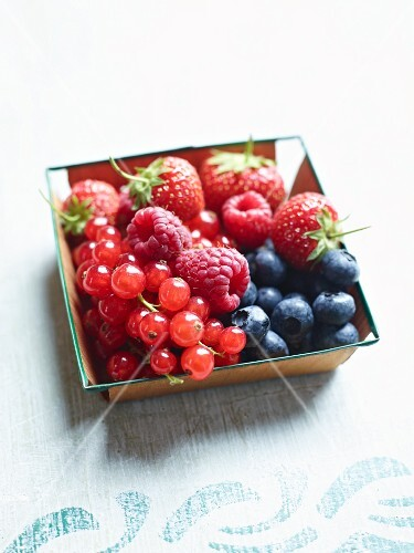 Fresh berries in a wooden basket