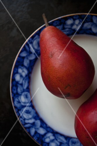 Two red pears on a plate