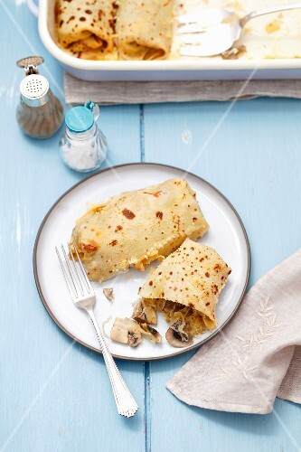 Oven-baked pancakes with sauerkraut and mushrooms