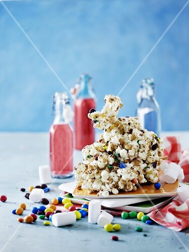 A popcorn figure on caramel sauce for a child's birthday party