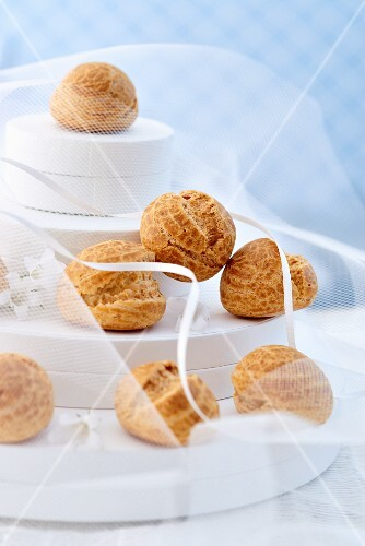 A multi-tiered wedding cake with profiteroles