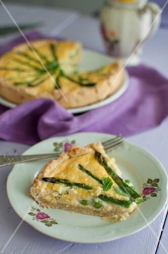 Quiche with asparagus, peas and fresh mint, sliced