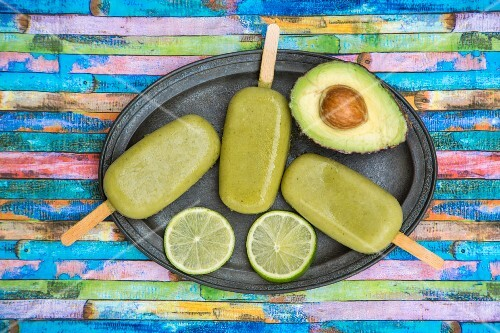 Homemade avocado ice lollies (seen from above)