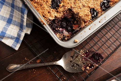 Warm blueberry crumble cake, sliced