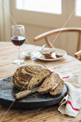 A table laid with bread and wine