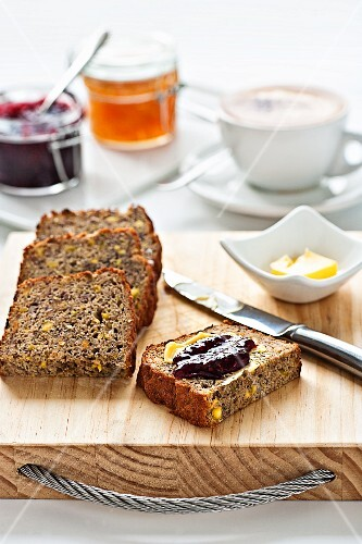 Banana bread with butter and jam