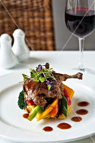 Glazed leg of pheasant with polenta and vegetables
