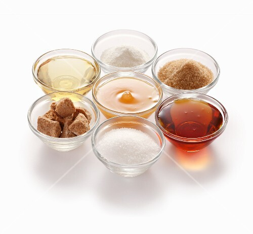 Natural sweeteners – clockwise from top: stevia, cane sugar, maple syrup, beet sugar, coconut flower sugar, agave syrup and honey
