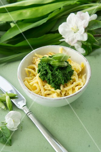 Spätzle (soft egg noodles from Swabia) with wild garlic purée and pickled wild garlic buds
