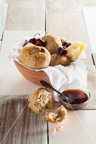 Nut rolls with mushrooms, cherries and date honey
