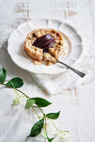 Ricotta crumble tart with a red wine pear