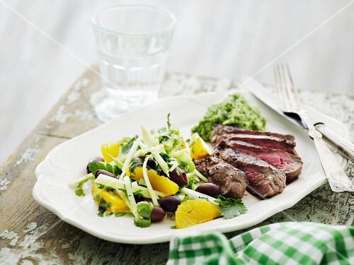 Beef steak with broccoli purée and a salad with orange fillets