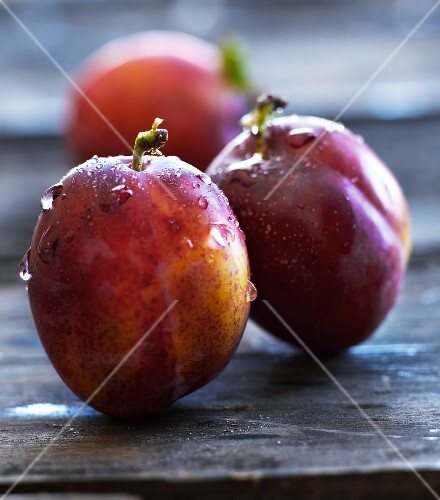 Plums on a wooden table
