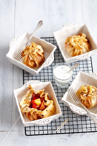 Pancake parcels with chicken, peppers and pineapple