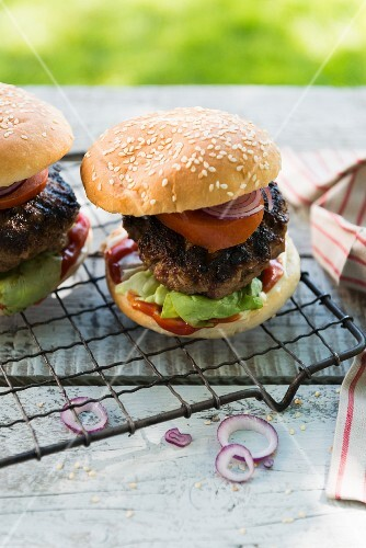 Grilled hamburgers on a garden table