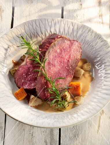 Roast beef with root vegetables and rosemary