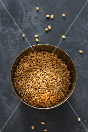 Fenugreek seeds in a metal bowl