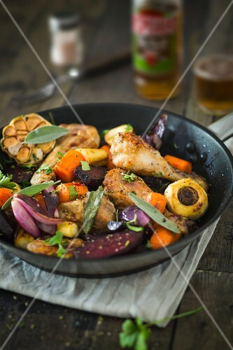 Chicken legs with root vegetables