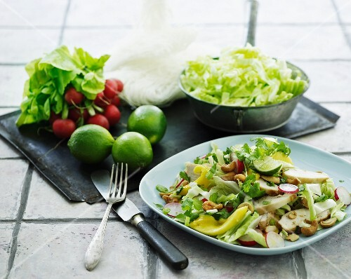 Iceberg lettuce with chicken, peppers, relishes and cashew nuts