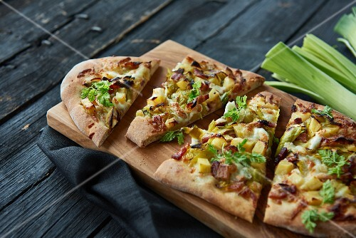 A rustic pizza with leeks, potatoes and bacon