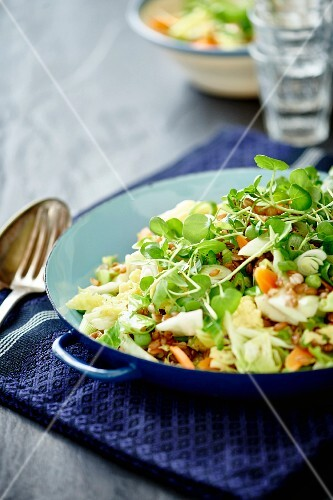 Fried rice with eggs, summer vegetables and herbs