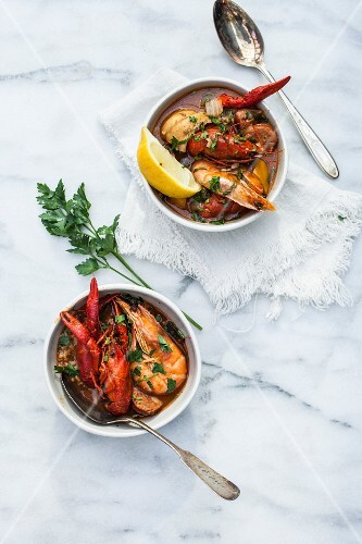 Crayfish stew with king prawns in soup bowls (Portugal)