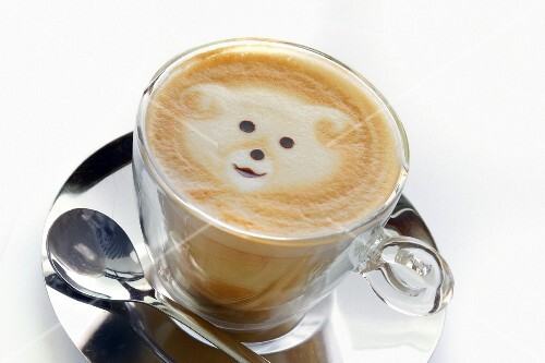 Cappuccino with a bear in the foam