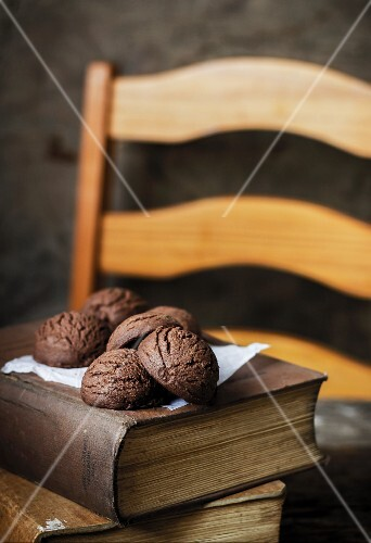 Frozen chocolate biscuits on an old book