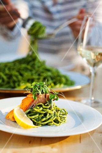 Linguine with pesto and salmon fillet