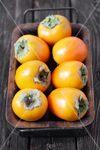 Fresh persimmons on a tray
