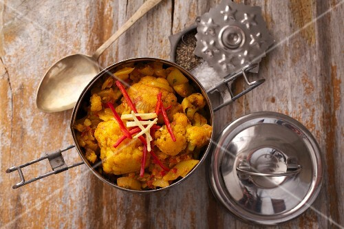 Aloo gobi (Indian cauliflower and potato curry) in a lunchbox