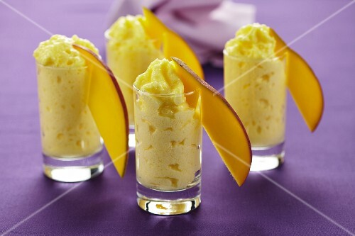 Glasses of mango quark dessert