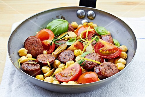 Fried chorizo chickpea with tomatoes and basil