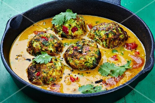 Courgette dumplings in a pepper sauce with coriander