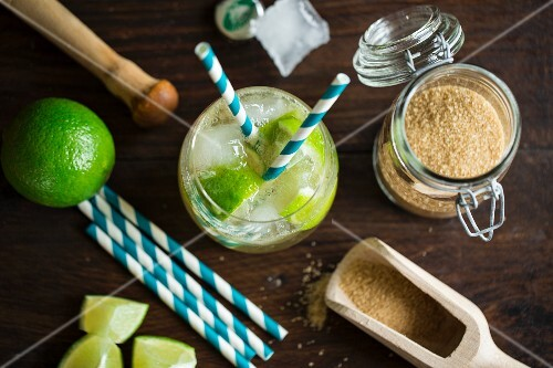 A Virgin Caipirinha Cocktail made from ginger ale, limes and brown sugar with straws