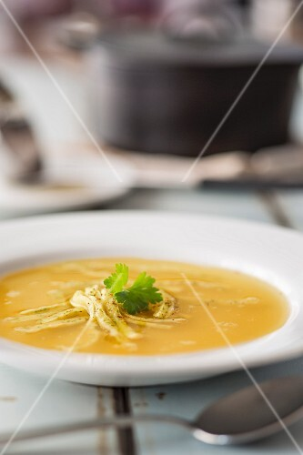 Flädlesuppe (Swabian soup made with pancake strips) with parsley