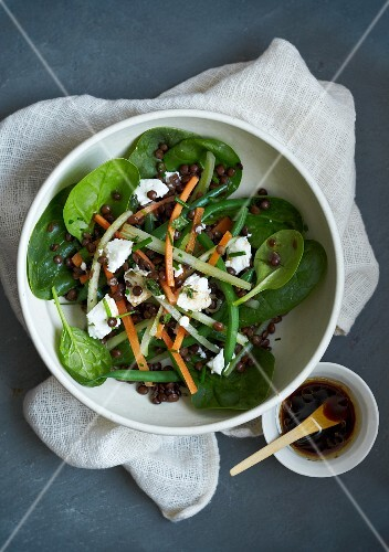 Spinach salad with lentils, beans and feta cheese