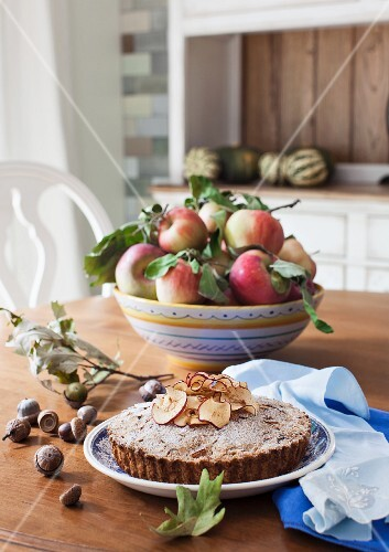 Apple and almond cake on an autumnal dining table