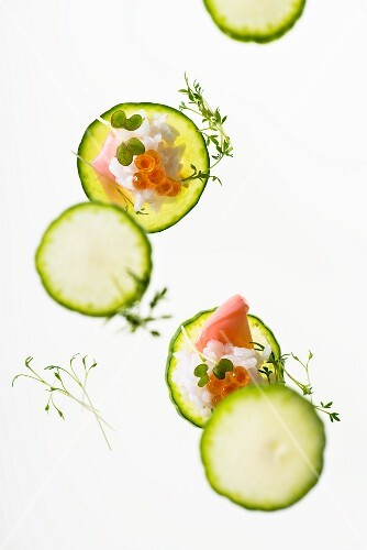 Cucumber slices with sushi rice, caviar and ginger