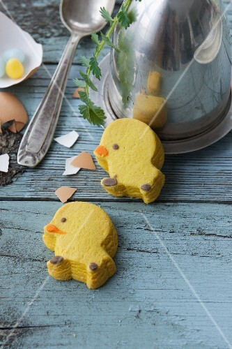 Chick biscuits on a rustic wooden surface
