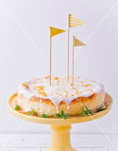 A lemon cheesecake decorated with little flags