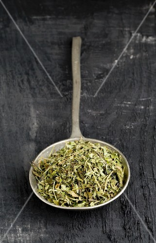 Dried oregano on a spoon