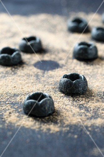 Homemade liquorice sweets made from liquorice root powder and sugar