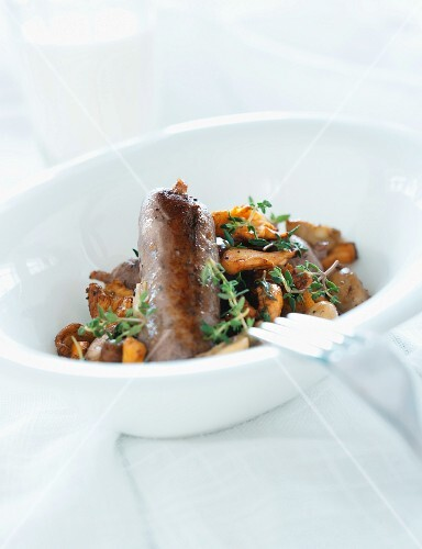 Sausage with a chanterelle mushroom salad