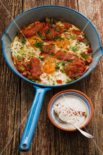 Turkish breakfast with tomatoes and fried eggs