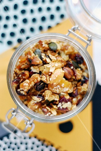 Homemade muesli with oats and pumpkin seeds in a jar