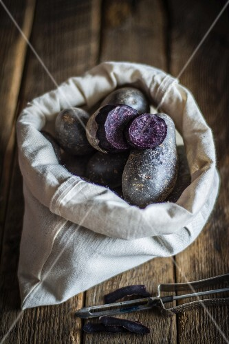 Purple potatoes in a fabric bag