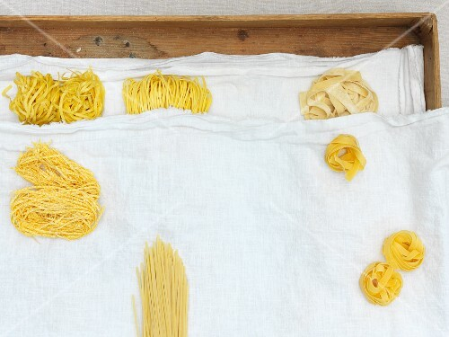 Dried and fresh pasta on a linen cloth