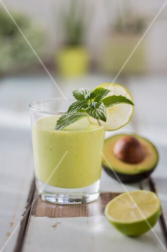 An avocado drink with limes and mint