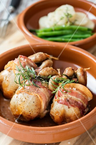 Quails wrapped in bacon